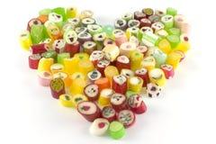 Plenty candies in heart shape Royalty Free Stock Photos