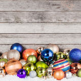 Plenty of Christmas Balls on Wooden Background Royalty Free Stock Photography