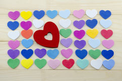Plenty of colorful hearts on a wooden table Stock Image