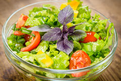 Plenty of cut vegetables on glass bowl Royalty Free Stock Photography
