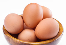 Plenty of eggs in wooden bowl Stock Photo