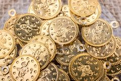 Plenty of fake gold coins are in the view stock photo