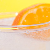 Plenty Of Fizz. A slice of orange and a glass of fizzy water Stock Photo