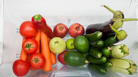 Plenty of fruits and vegetables. Open fridge filled with fruits and vegetables Royalty Free Stock Photography