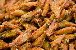 Plenty of fry chicken wings. Fried chicken wings on the urban market of Thailand, crispy and yummy Stock Photography