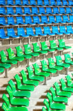 Plenty of green and blue plastic seats at stadium . Royalty Free Stock Photography