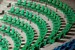 Plenty of green plastic seats at stadium . Royalty Free Stock Image
