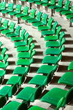 Plenty of green plastic seats at stadium . Royalty Free Stock Photo