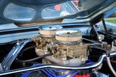 Plenty of intake. Dual four barrel carburetors mounted on high rise intake manifold Stock Photo