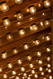 Plenty light bulbs shining bright. Many lightbulbs in rows on ceiling burn Stock Photo