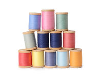 Plenty multicolor threads bobbins isolated on white background. Atelier, sewing accessories Stock Image