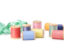 Plenty multicolor threads bobbins isolated on white background. Atelier, sewing accessories Royalty Free Stock Photos