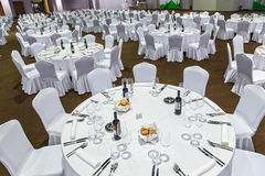 Free Plenty Of Big Round Tables And Chairs Covered With White Tablecloth Are Set For A Meal In The Gorky Gorod Restaurant. Wide Angle I Royalty Free Stock Images - 89727429