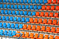Plenty of orange and blue plastic seats at stadium . Royalty Free Stock Images
