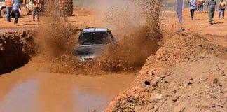 Plenty of passing through muddy terrain vehicle. Plenty of muddy motorsport.off-road vehicle and dirt track.Italian off-road track.plenty of passing through Royalty Free Stock Image