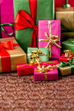Plenty of Presents Crammed into one Shot. Single-colored gifts placed on a festive cloth. Tightly framed shot. Strong contrast between packed background and void Royalty Free Stock Photos