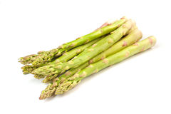Plenty of raw green asparagus. Isolated on white Stock Image