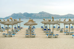 Plenty of sun loungers. Plenty of sun loungers on the beach royalty free stock photography