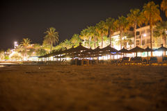 Plenty of sun loungers. Plenty of sun loungers on the beach at night stock image
