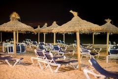 Plenty of sun loungers. Plenty of sun loungers on the beach at night royalty free stock photography