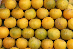 Plenty of tangerines or oranges in a market Stock Photos