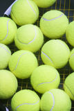 Plenty of tennis Balls on Raquet Strings. Against Black background. Vertical Image Stock Photography