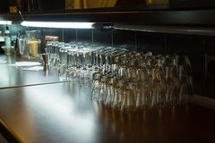 Plenty Transparent Glasses Piled on Wooden Table Royalty Free Stock Images