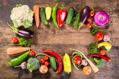Plenty of vegetables on wooden table. Plenty of colorful vegetables on wooden background with copy space Royalty Free Stock Photography