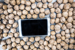Plenty of walnuts with tablet pc stock image