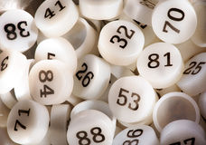 Plenty of White Plastic Bingo Game Numbers Stock Photography