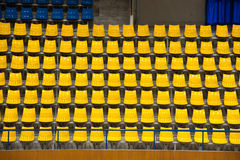 Plenty of yellow and blue plastic seats at stadium . Royalty Free Stock Images