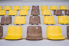 Plenty of yellow plastic seats Stock Photography