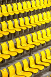 Plenty of yellow plastic seats at stadium . Royalty Free Stock Image