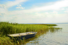 Plesheevo lake. The great boat floats on the shore of Plesheevo lake in the summer in Russia royalty free stock photos