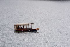 The Pletna boat on the Bled lake in Slovenia royalty free stock photography