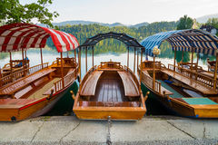 Pletna boats dock on Lake Bled in Slovenia Royalty Free Stock Photo
