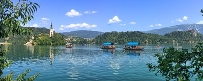 Pletna boats on Lake Bled, Slovenia royalty free stock photo
