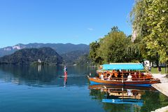 Pletna boats and paddle board, Lake Bled, Slovenia Stock Photo