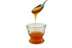 pleuvoir à torrents en verre de miel de cuvette petit Images stock