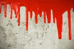Pleuvoir à torrents rouge de peinture Photo stock