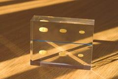 Plexiglass Pieces. Plexiglass piece with medicine trapped inside royalty free stock image