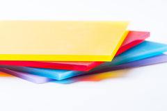 Plexiglass sheets colored. Orange yellow red blue purple plexi glass sheets on the white background Royalty Free Stock Photos