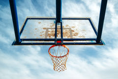 Plexiglass street basketball board with hoop on outdoor court Stock Image