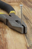 Plier and nails Royalty Free Stock Image