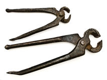Pliers. Photo of the old rusty pliers against the white background Royalty Free Stock Photos