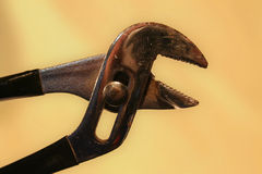 Pliers. Adjustable Wrench set against a blurred background Royalty Free Stock Photography
