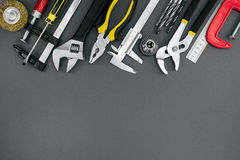 Pliers and adjustable wrenches, ruler, clamp, vernier caliper on Royalty Free Stock Image