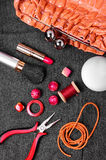 Pliers,beads, and womens accessories Stock Photography