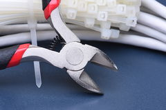 Pliers with cables and bunch of cable ties Stock Images