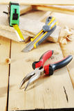 Pliers and a cutter lie on the workbench Stock Photo